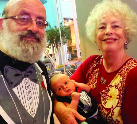 Marc and Leah with their grandson